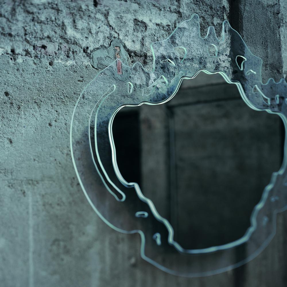 Rokoko mirror designed by Nanda Vigo for Glas Italia.