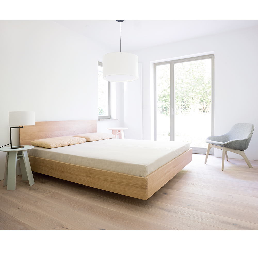 Simple Hi bed solid oak and Morph Lounge upholstered modern chair Zeitraum