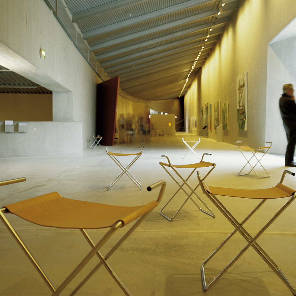 xsit folding chair erik magnussen engelbrechts contemporary modern designer leather chrome folding chair