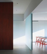Shop SUITE NY for CH-24 Wishbone Chairs in red and other colors designed by Hans J. Wegner for Carl Hansen & Son as seen in the Pilgrim Road House designed by Deborah Berke Architecture. SUITE NY is the premier resource for contemporary furniture and modern design.