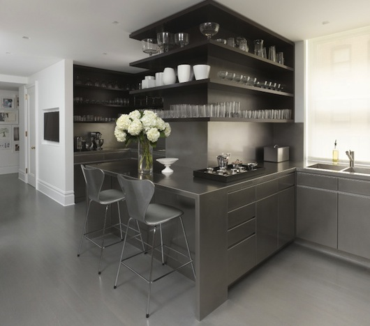 Shop SUITE NY for the Series 7 counter stool designed by Arne Jacobsen for Fritz Hansen as seen in this contemporary stainless steel kitchen designed by MR Architecture + Decor. SUITE NY is the premier resource for contemporary furniture and modern design.